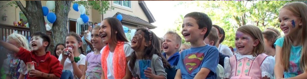 kids laughing at outdoor magic party