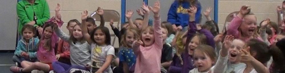 Girls enjoying the magic show at a fundraiser show in Littleton